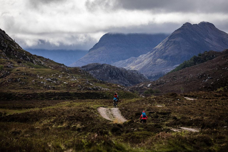 Undulating double track through the hills, bikerafting Scotland