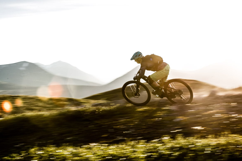 Mountain bike guide Marissa showing speed in the Yukon in photos