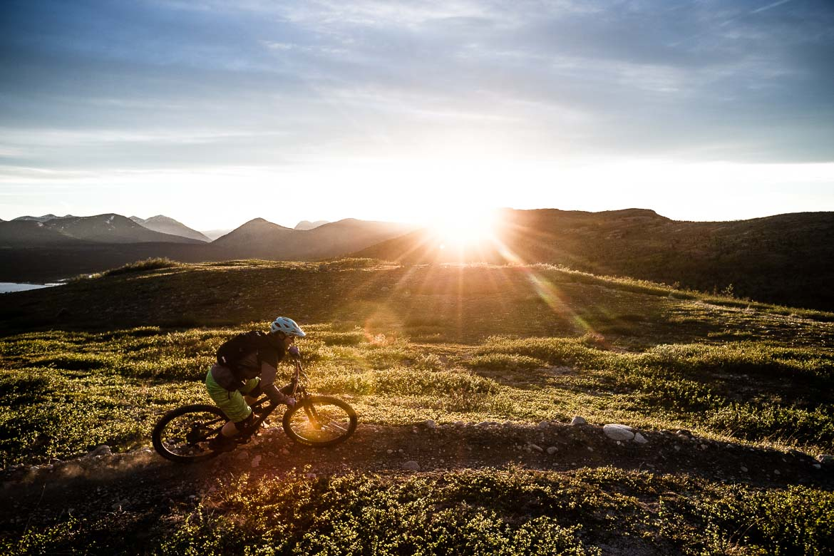 mountain bike guide Marissa enjoying the last light of the day with the Yukon in photos
