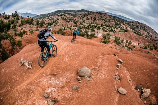 Riders descend trails on our Mountain bike tour Morocco, Top 10 trails