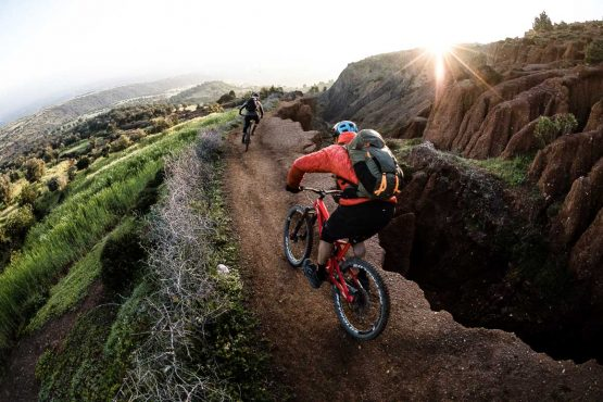 Fast and flowy in Africa - Eric Porter with his MTB guide on trail in Morocco, Africa