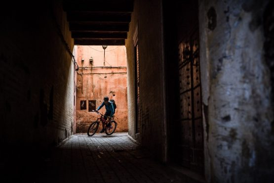 Eric riding through the tight streets of Marrakech Morocco on our MTB vacation Morocco