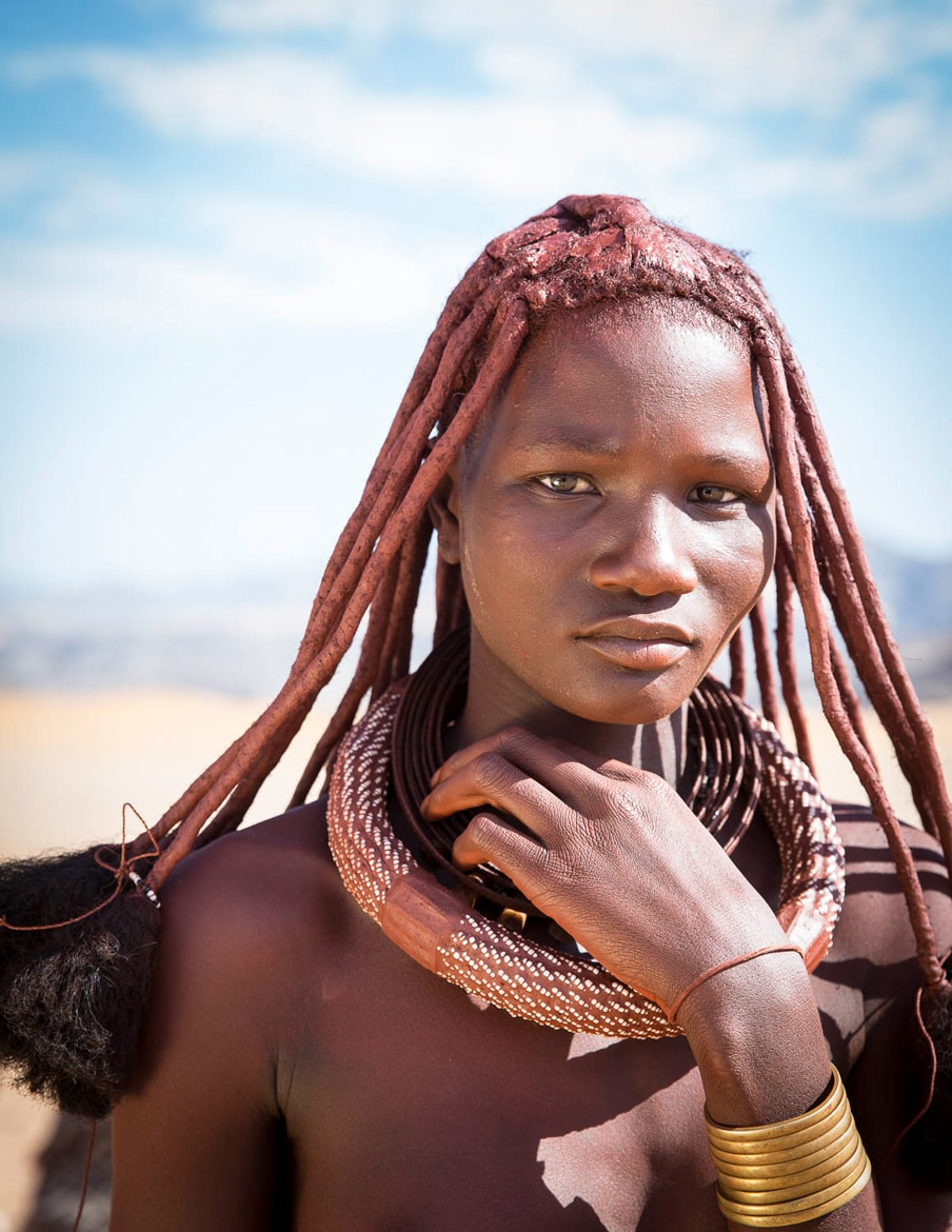 Young Himba woman, mountain bike adventures Africa