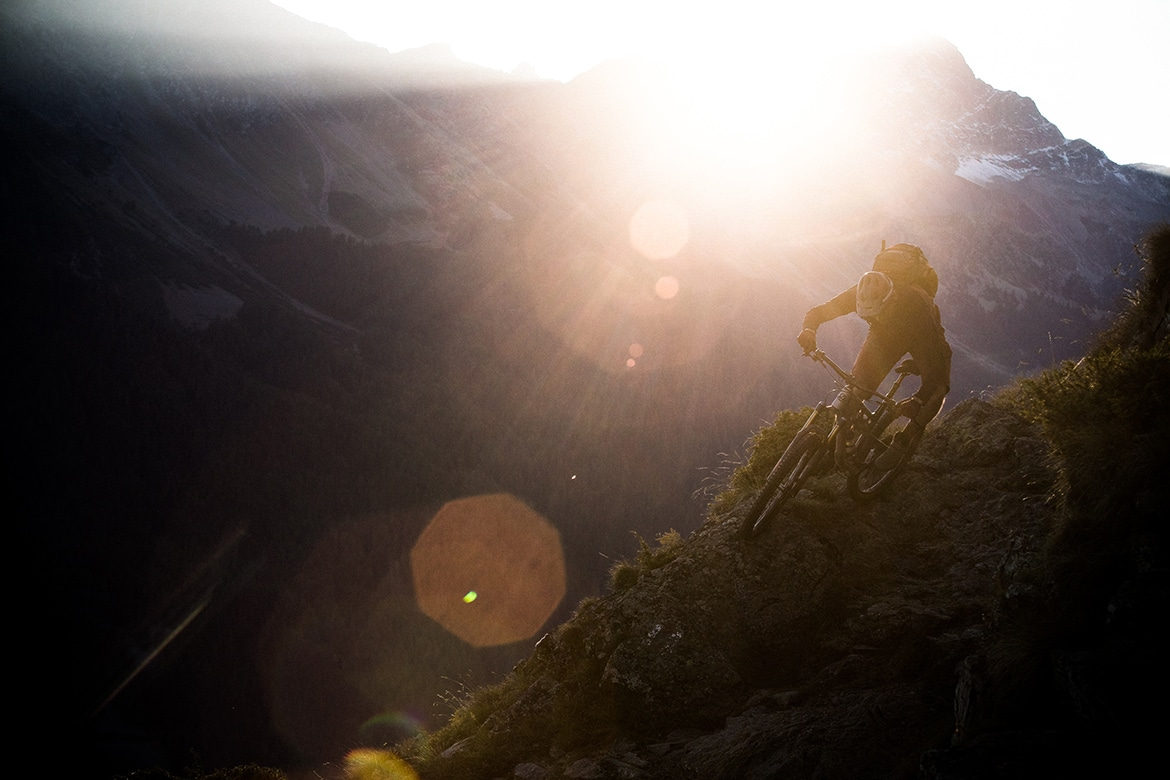 Thomas Vanderham riding a Rocky Mountain bike at sunset in the Swiss Alps, selected as part of our Top 10 MTB photos.