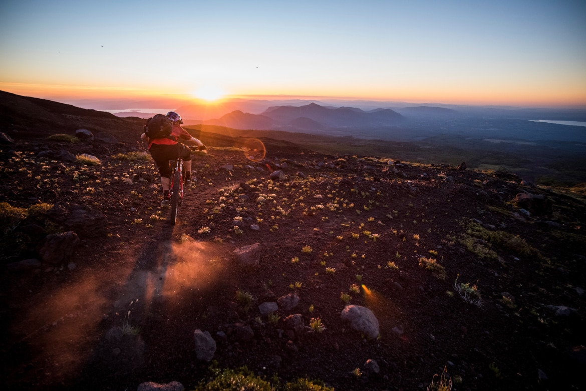 Rene Wildhaber kicking up dust whilst riding in Chile as featured in our mountain bike adventures South America