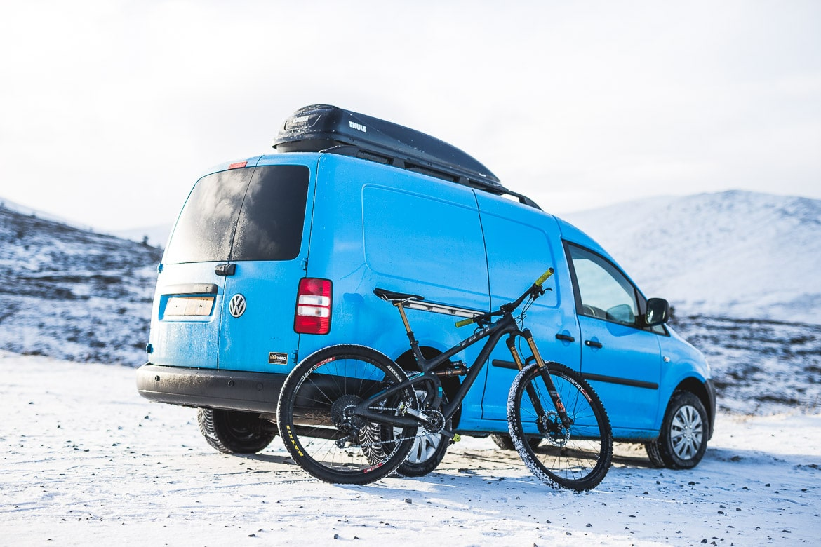 Preparing for a day on the snowy trails in the Cairngorms with local Aviemore mountain bike guide Chris Gibbs