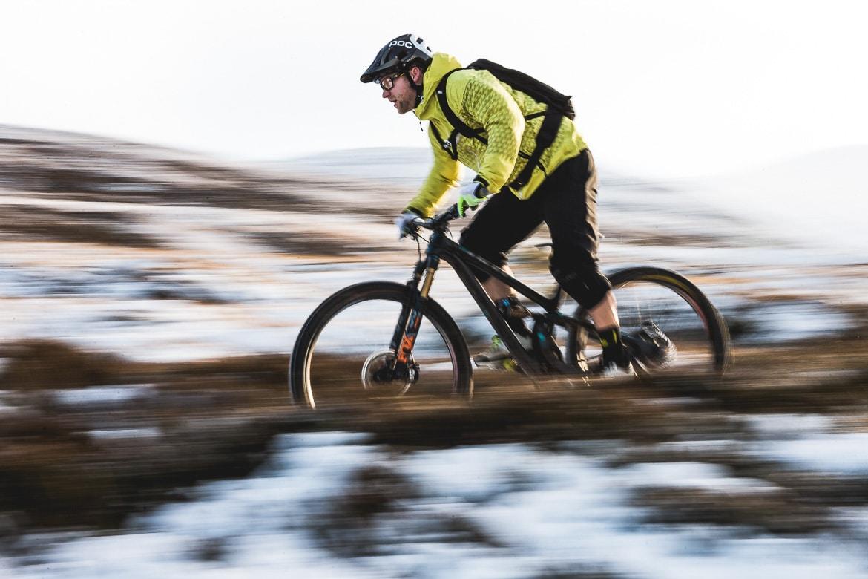 Local Aviemore mountain bike guide Chris Gibbs speeding down a descent.