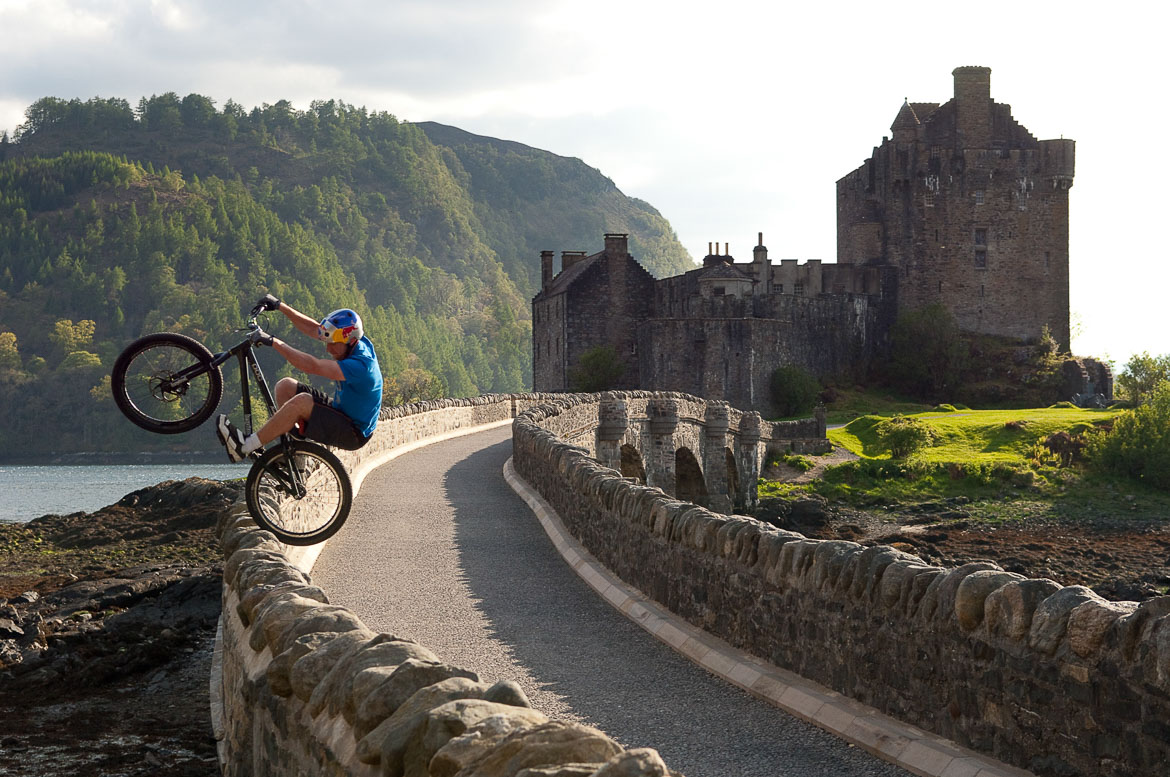Danny MacAskill riding on Eilean Donan castle before Heli-Biking with Danny MacAskill, Steve Peat, Hans Rey in the Torridon mountains and Isle of Skye