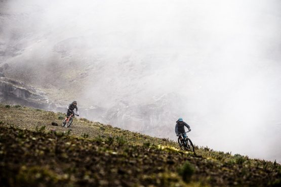 Riding out of the mist on our mtb tour Ecuador