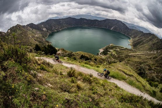 Racing past Quilotoa on the mountain bike tour Ecuador
