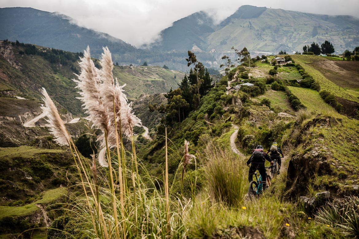 Riding crater ridge lines on our Mountain biking Ecuador trip