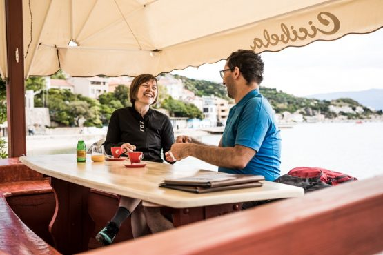 E-MTB tour of Croatia taking a coffee break in Baška