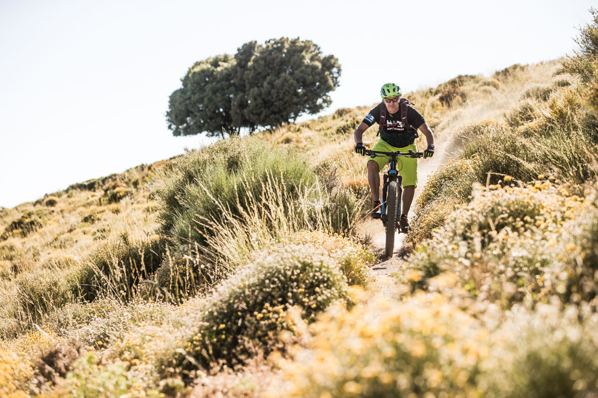 Blasting through the bushes on a E-MTB Tour Spain