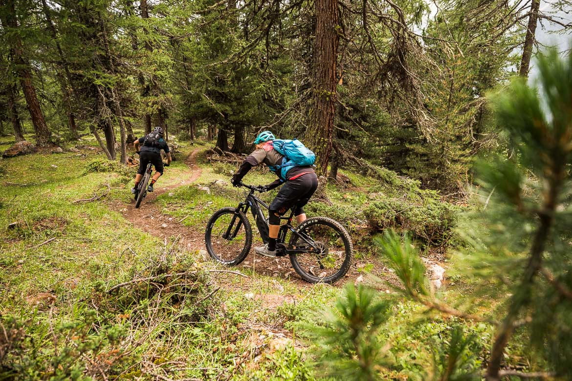 Flowing through the pine forests in a E-MTB Tour In Switzerland