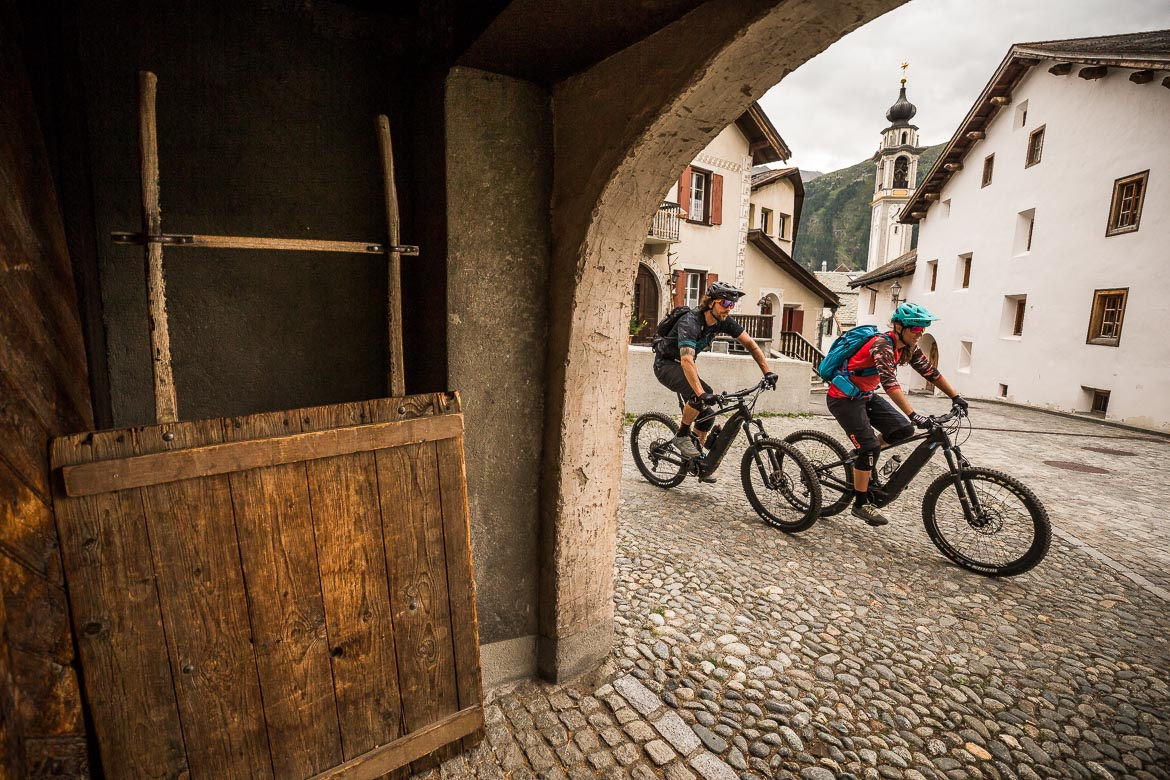 Passing through the picturesque towns on a E-MTB Tour In Switzerland