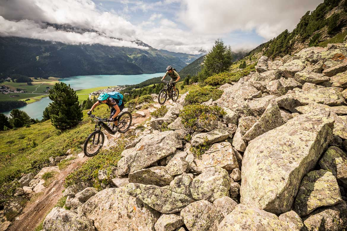 Above the lake of St. Moritz on a E-MTB Tour In Switzerland