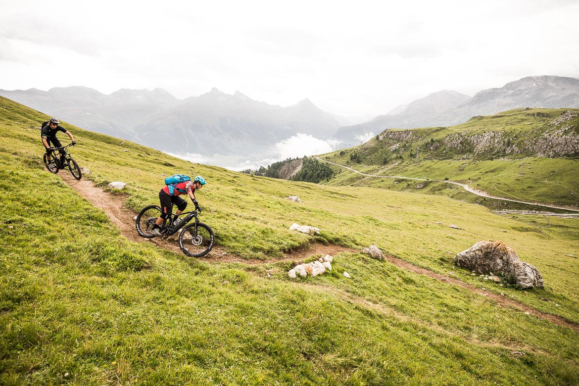 Flowing through wide alpine pastures on a E-MTB Tour In Switzerland