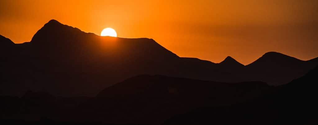 A fiery African sunset on a E-MTB safari of Namibia.