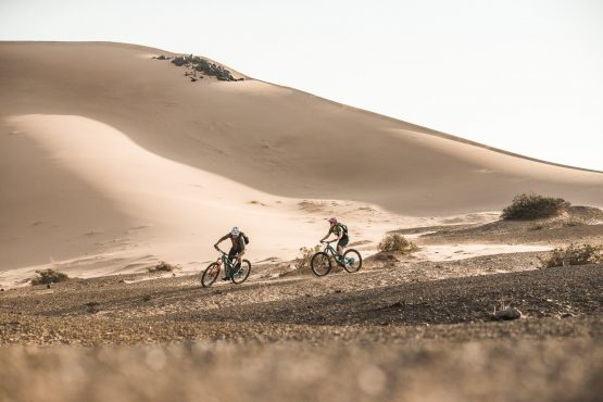 Descending on dusty trails on a mountain bike safari tour Namibia