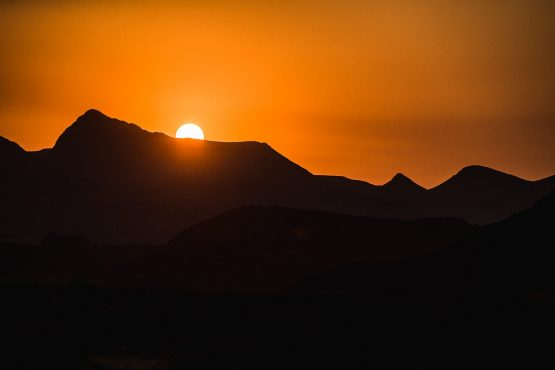 A fiery African sunset on a mountain bike safari tour Namibia
