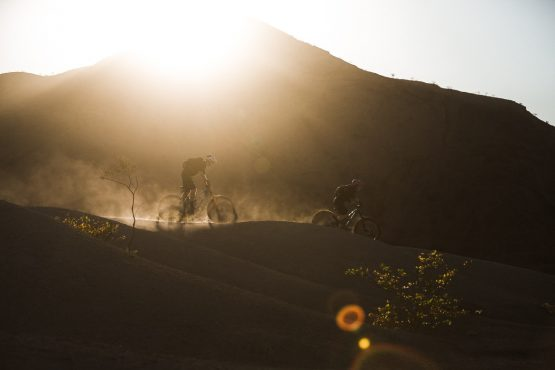 Descending in the golden light on a mountain bike safari tour Namibia