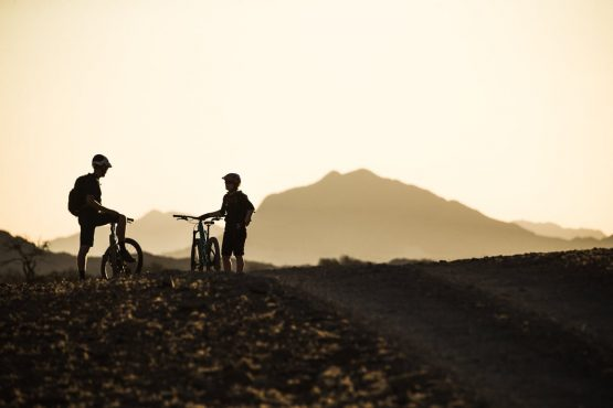 Taking in the sunset on a mountain bike safari tour Namibia