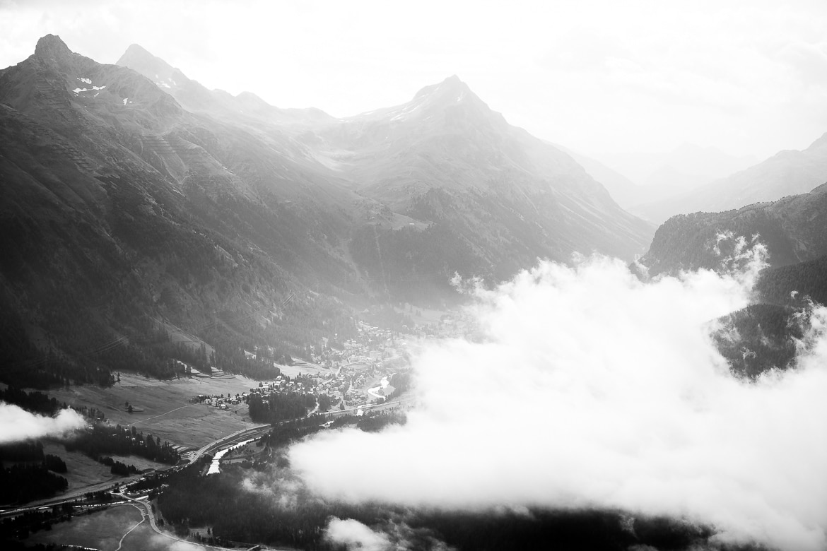 Cloud rolling through the Engadin Valley during an at home with local Swiss guide Dave Spielmann on a E-MTB tour in Switzerland