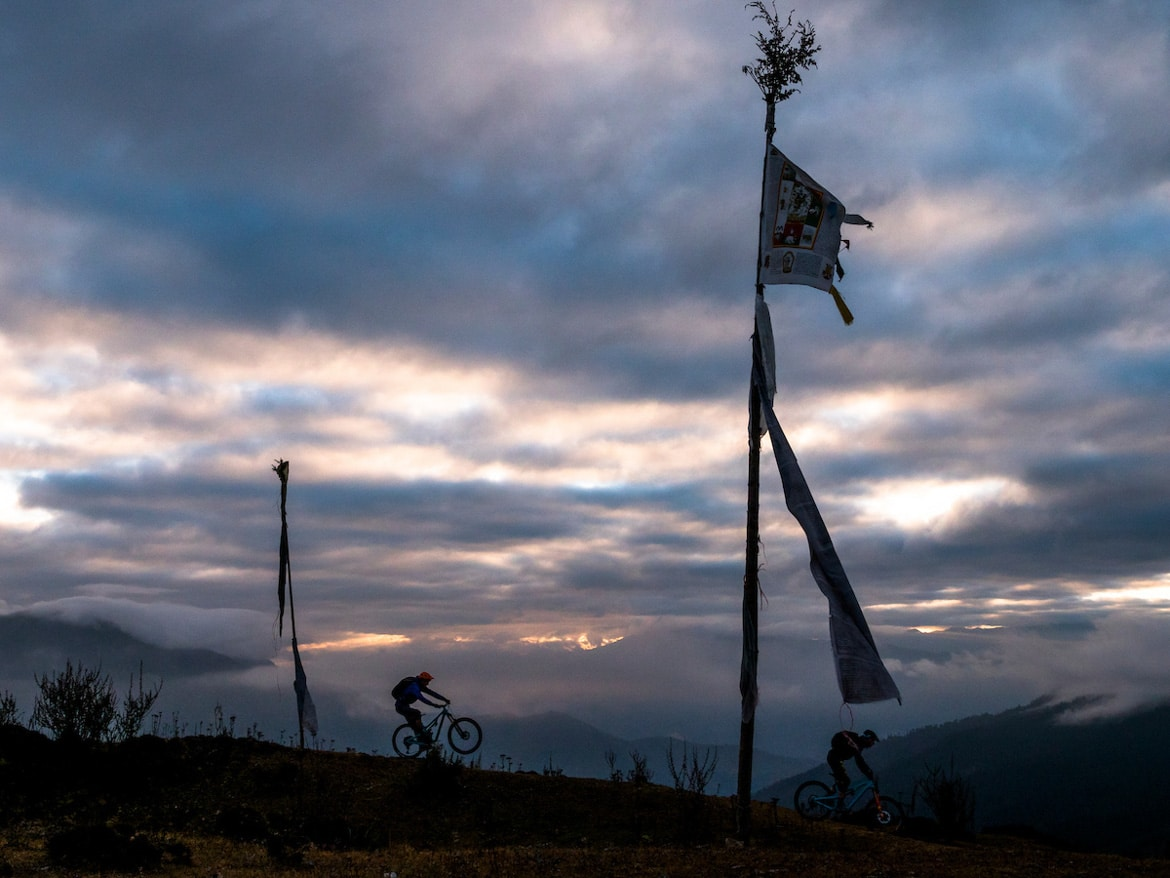 Heading back to the valley floor at dusk whilst mountain biking in Bhutan
