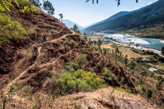 Mountain bike tour Bhutan descending to the valley floor