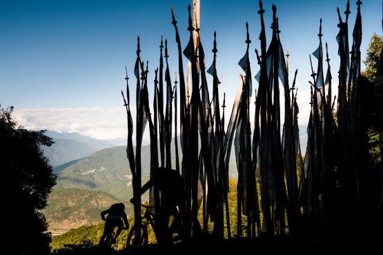 Mountain bike tour Bhutan flag landmarks