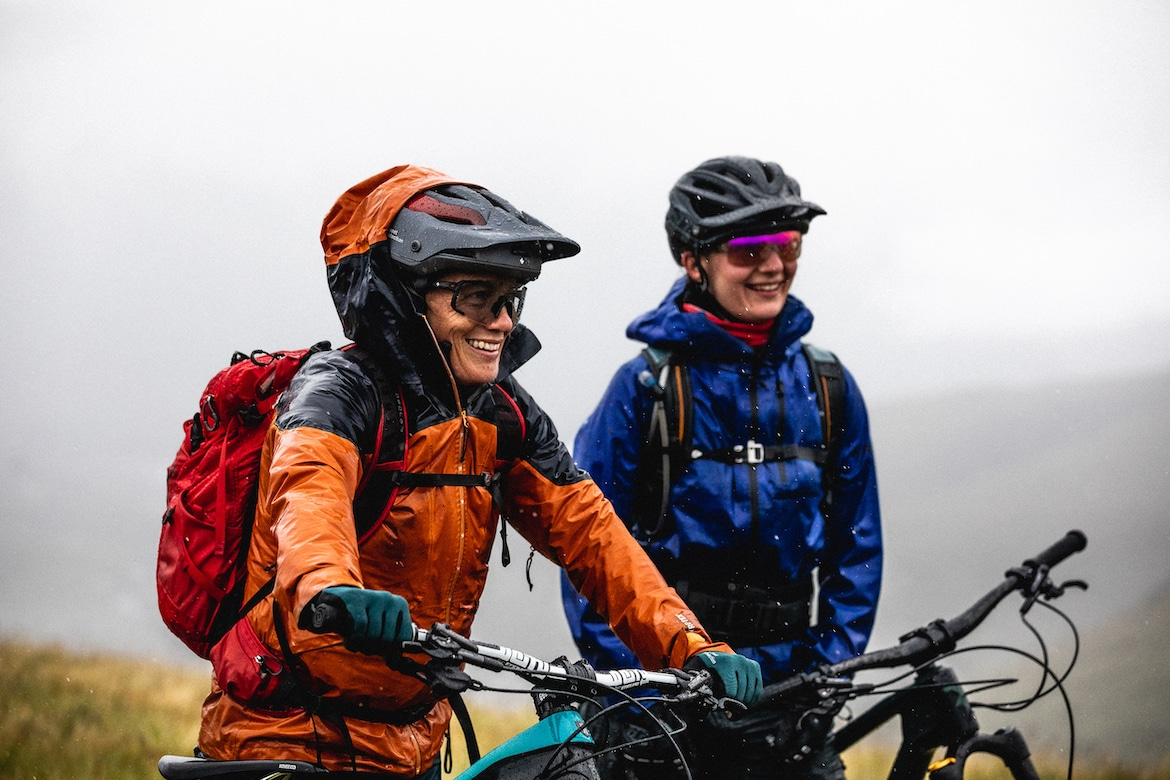Tracy Moseley + Manon Carpenter smiling through the rain