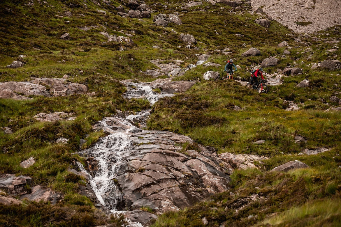 Tracy Moseley, Manon Carpenter next to waterfalls in Scotland