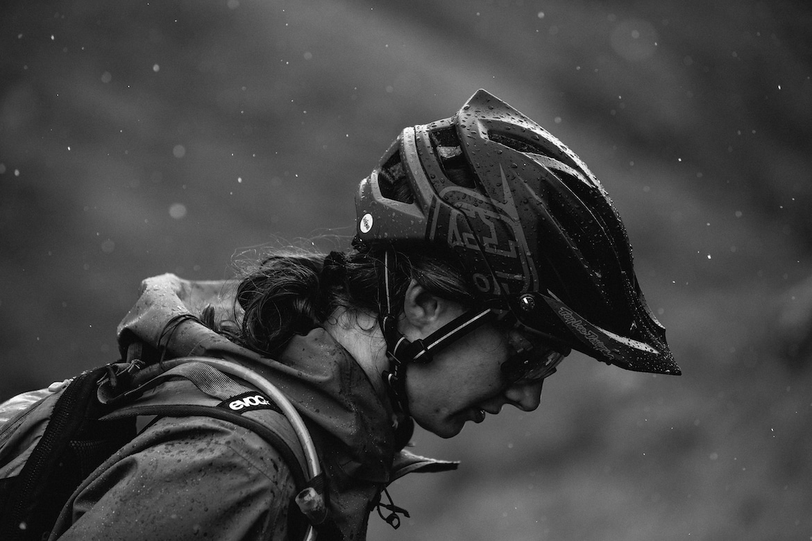Manon Carpenter mountain biking in the rain in Scotland