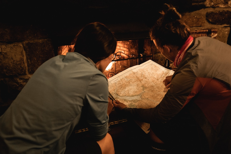 Tracy Moseley + Manon Carpenter reading a map