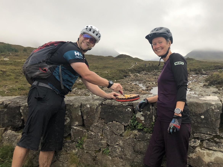 Highland MTB adventure, riders with birthday cake