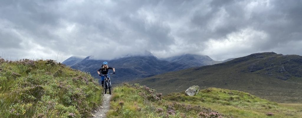 Highland MTB Adventure, mountain biker under grey skies