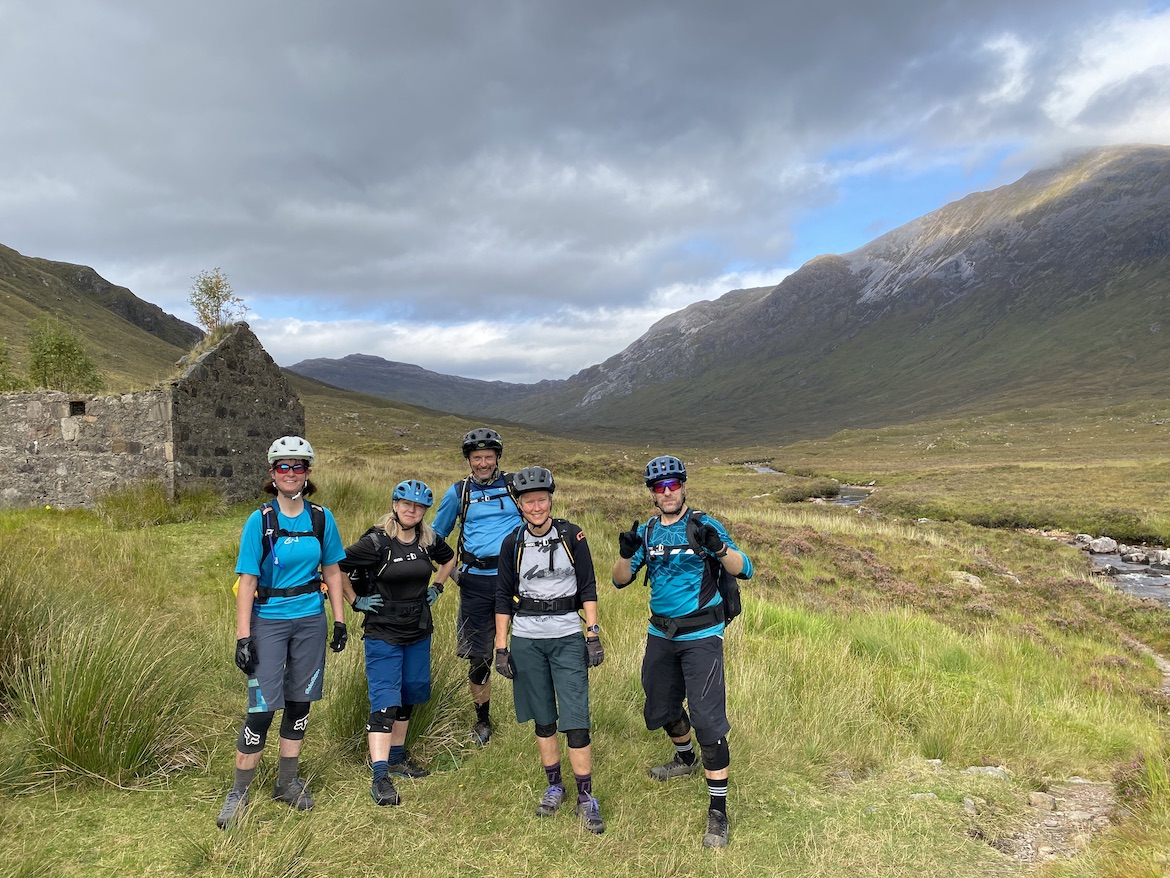 Highland MTB adventure, mountain bikers in front of bothy